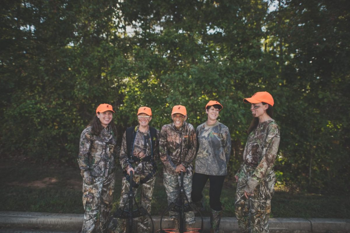 Women hunters posing before a hunt
