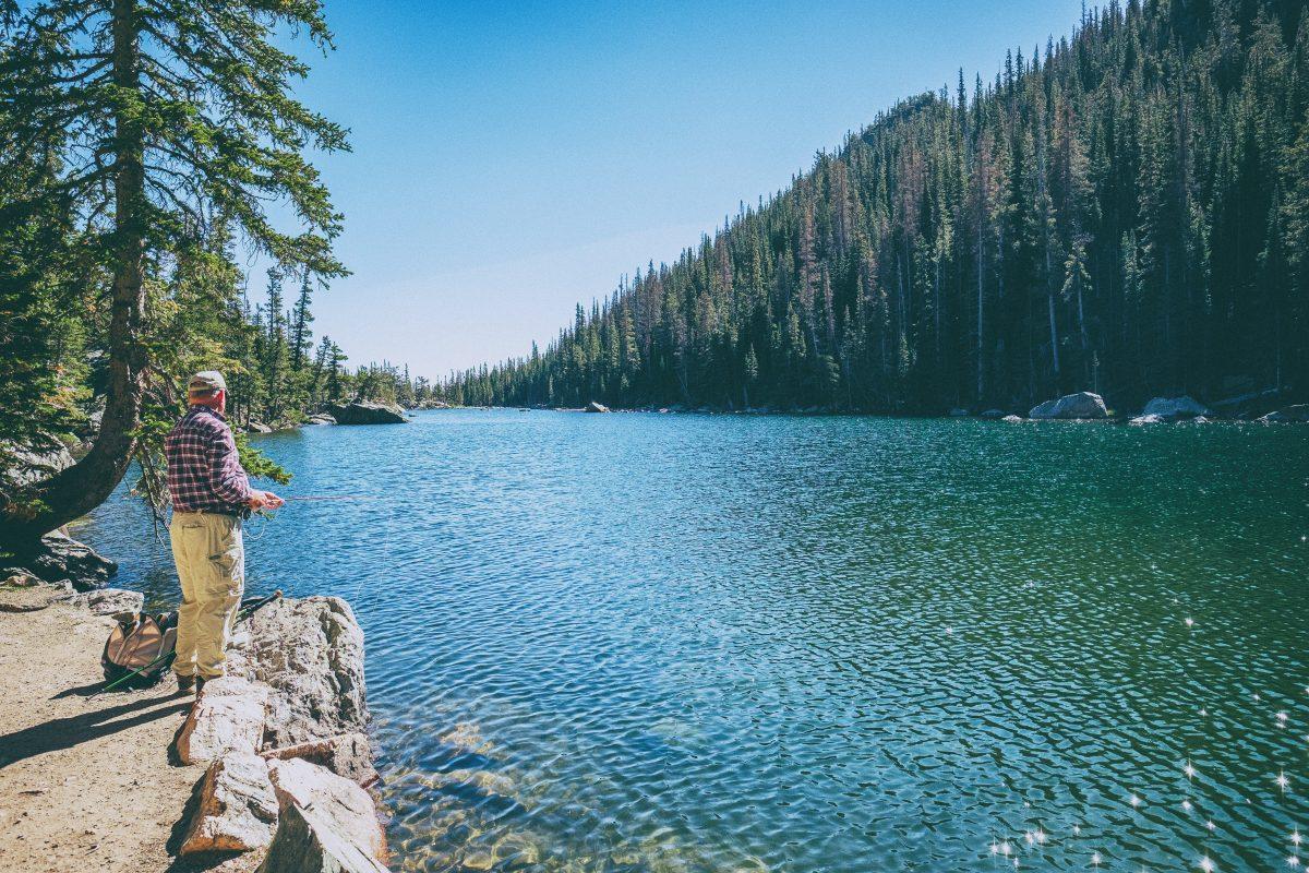 Man fishing at Emerald Lake in Colorado