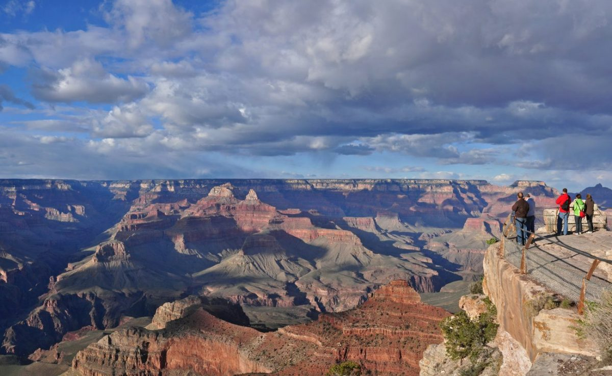 A view of people looking out into the Grand Canyon