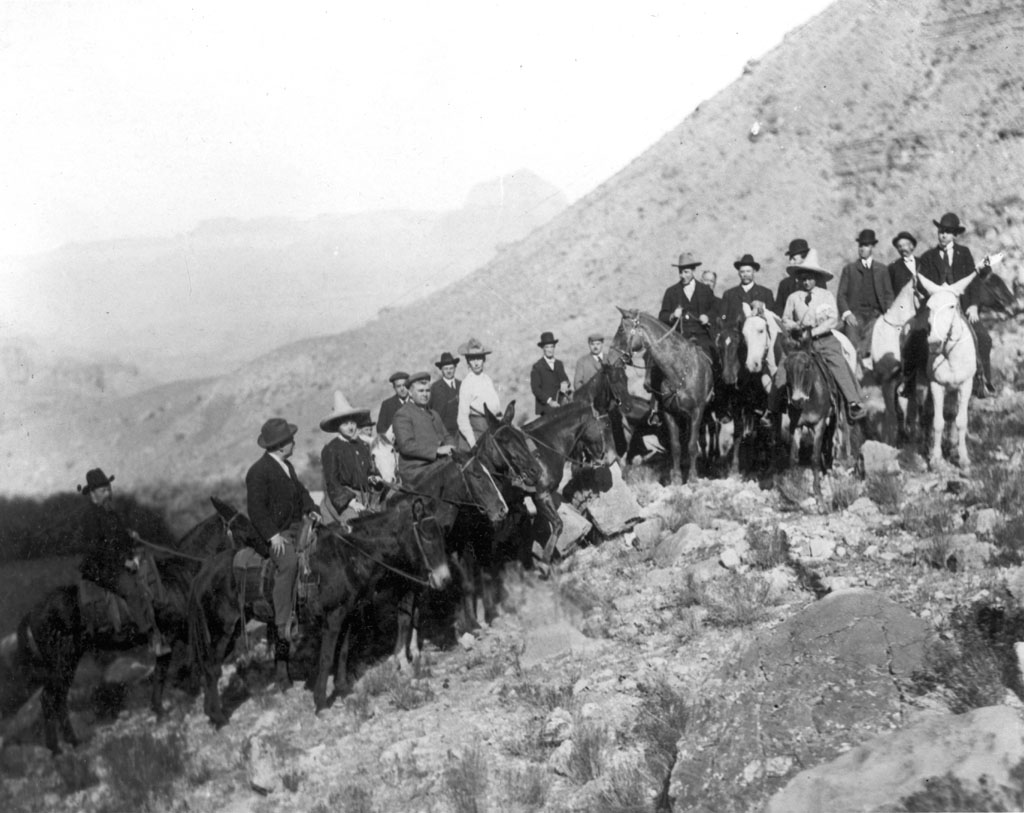 Tourist party traveling the Bass Trail in Grand Canyon National Park by horseback (circa 1910)