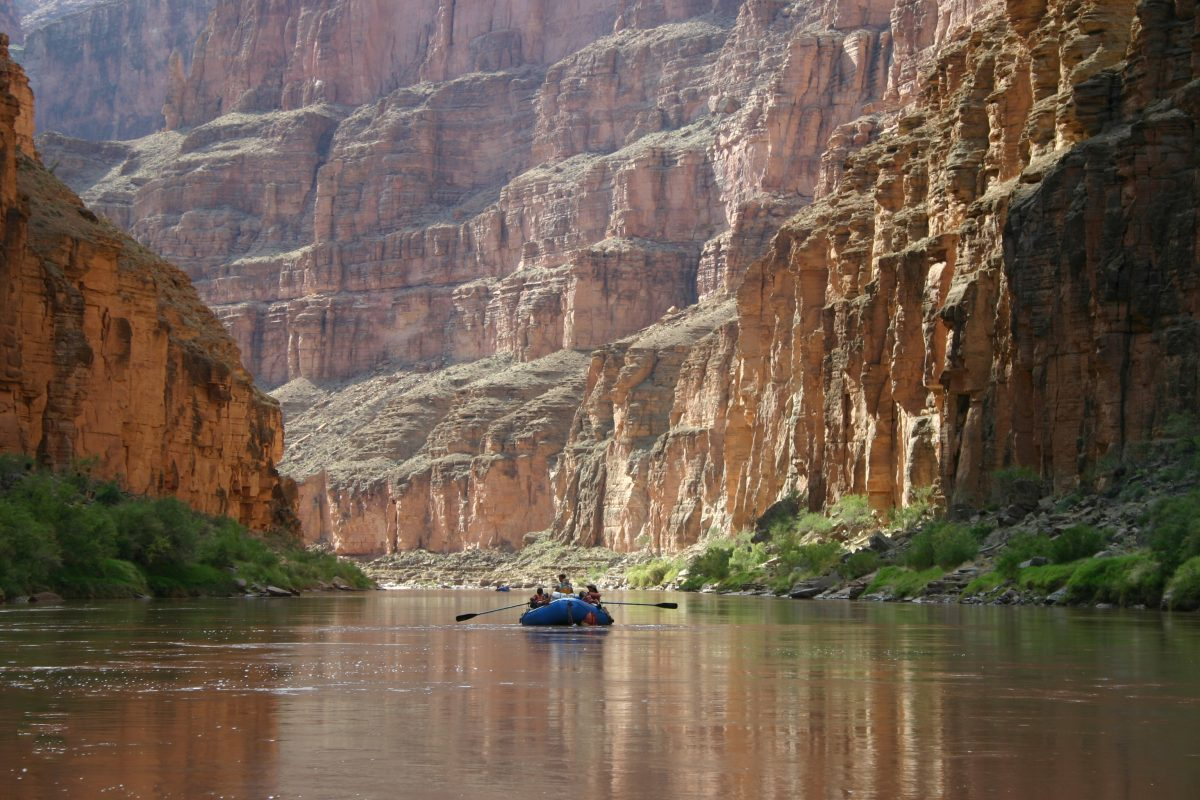 People rafting down the Colorado River in the Grand Canyon