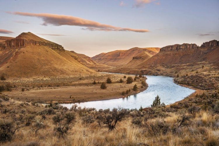 The sun rising along the John Day River in Oregon